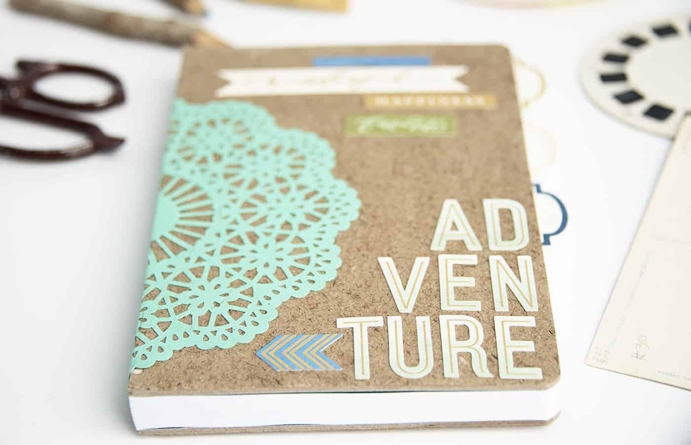 Adventure themed diy notebook gift mod podge rocks for Idea diy door gift