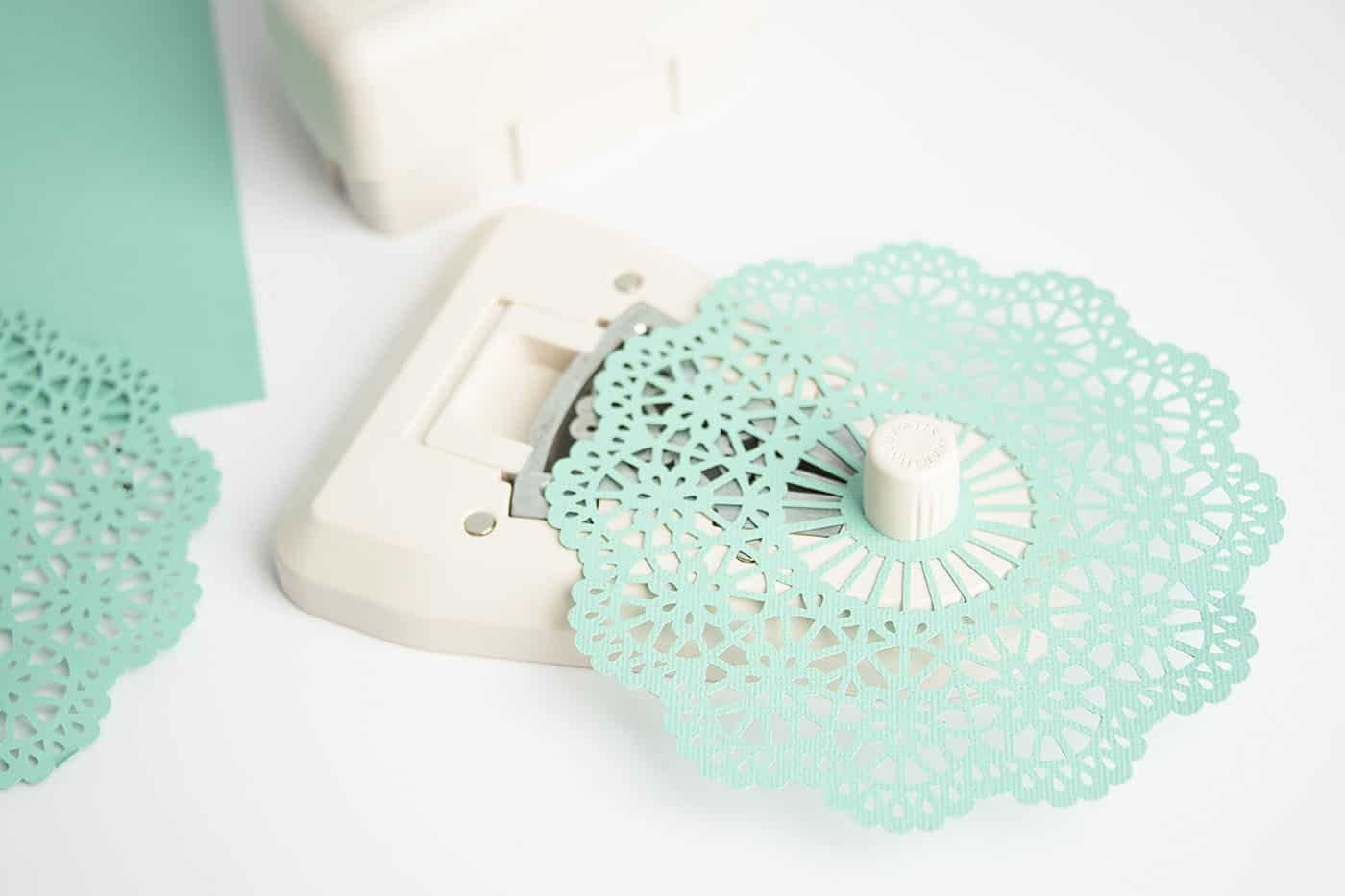 Cutting paper with a doily punch from scrapbook paper