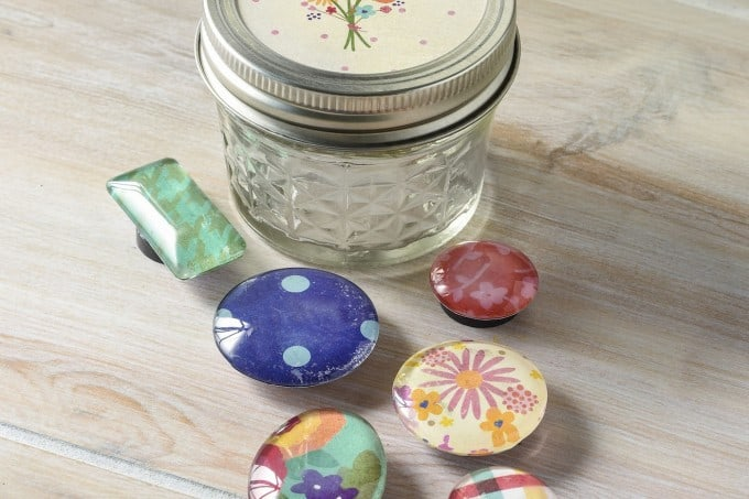 These DIY magnets are very easy to make with Mod Podge and paper scraps. Placing them in a small mason jar makes them the perfect hostess gift idea!