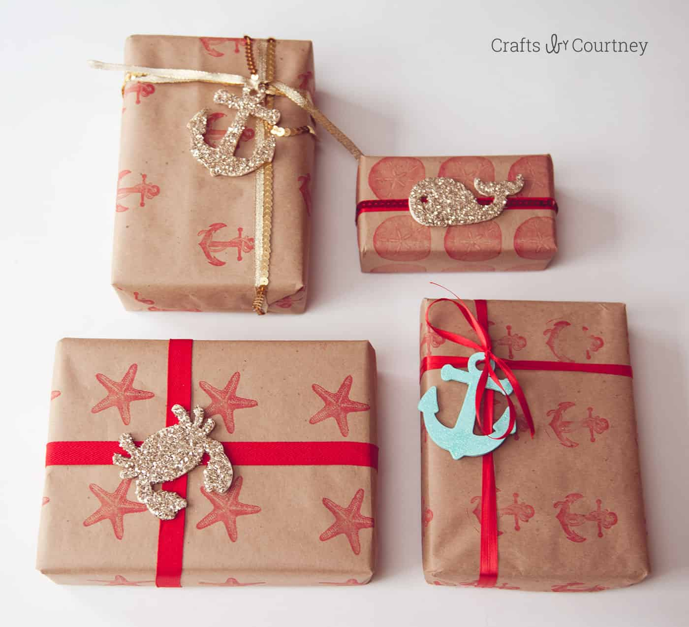 I fell in love with a beautiful nautical gift wrap from a magazine - so I decided to make my own DIY wrapping paper using stamps and glitter. So pretty!