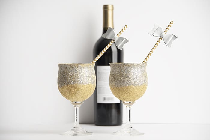 Make beautiful glitter glasses with Mod Podge to celebrate New Year's Eve - or any other celebration. The best part is you can wash these!