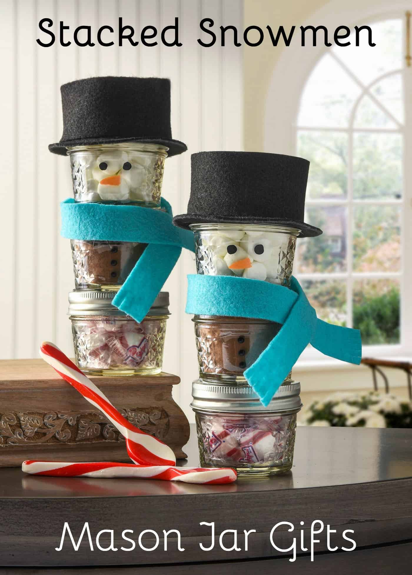 These cute snowmen mason jar gifts are so easy to make - just use felt and paint. Add hot cocoa, mints, and marshmallows to make them a lovely gift idea.