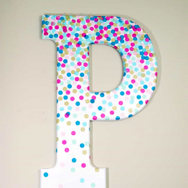 Learn how to make decorative letters using confetti and Mod Podge! This project is perfect for a kids' room or craft studio.