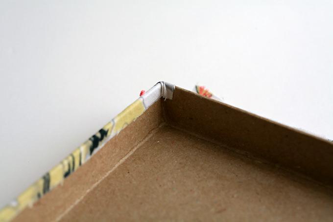 Fold the fabric edges over the box