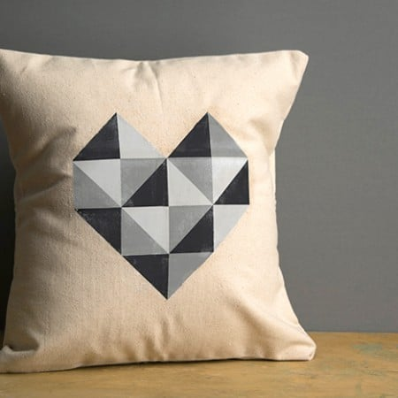 If you love the idea of having pillows you can rotate out for the holidays, but don't want to spend a lot of money, try this photo transfer pillow! The free geometric heart printable is included.