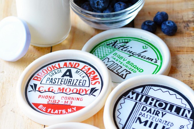 These custom coasters are made with supplies from the dollar store, and they look like vintage milk lids! Get the free printable and tutorial here.