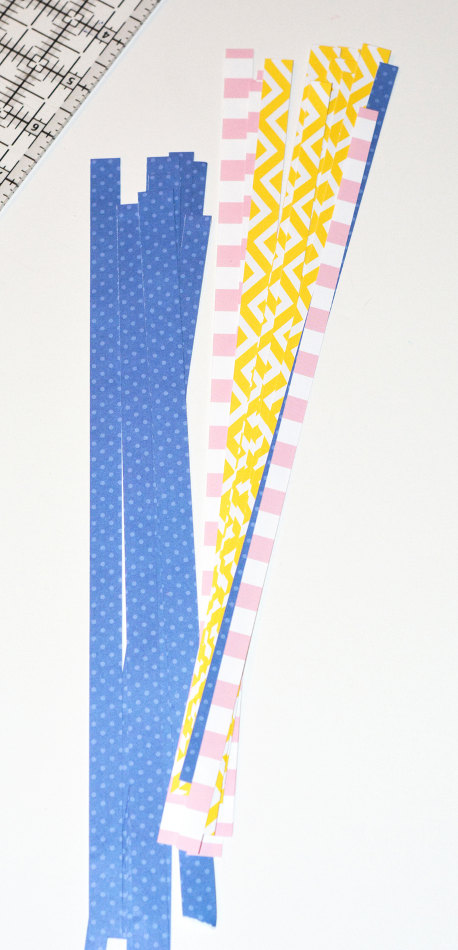 Long strips of scrapbook paper in a pile