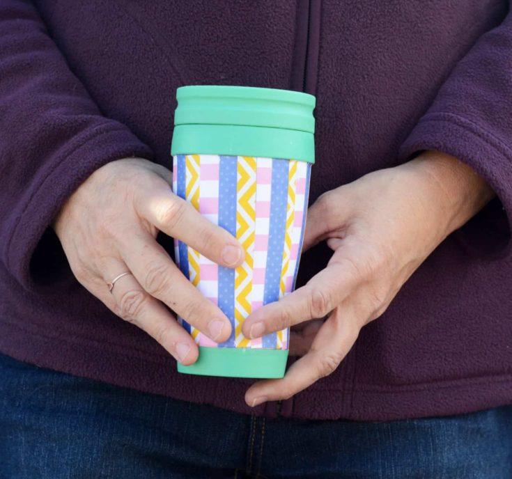 Decorated travel mug
