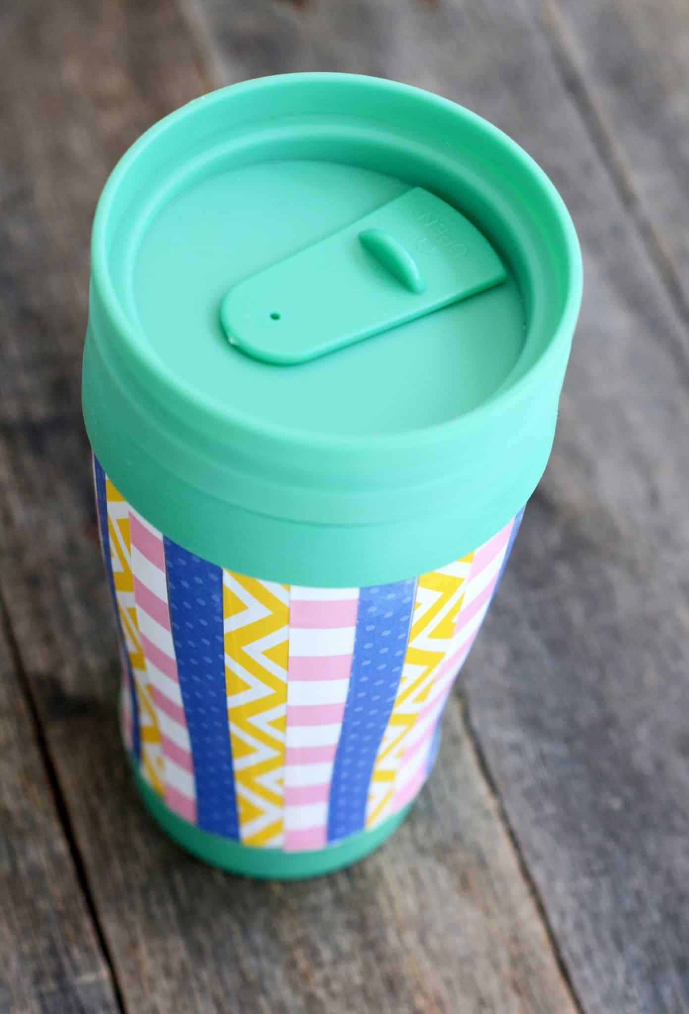 Decorate a travel mug with paper and Dishwasher Safe Mod Podge