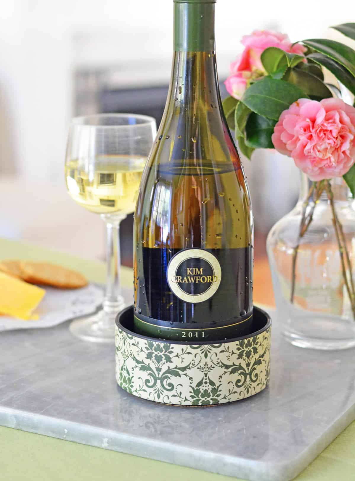"Use a 4"" PVC pipe cap to make a unique wine bottle coaster! It's perfect for parties and you can't even tell it's plastic when you're done."