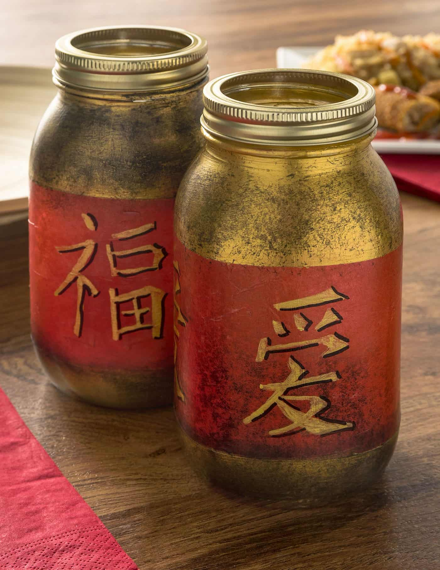 Turn regular mason jars into a fun Chinese New Year craft with tissue paper, paint, and Mod Podge. These are perfect for a themed party!