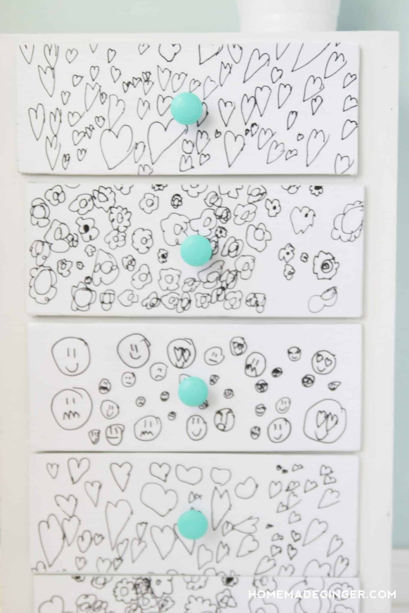 Child's drawings on the front of dresser drawers