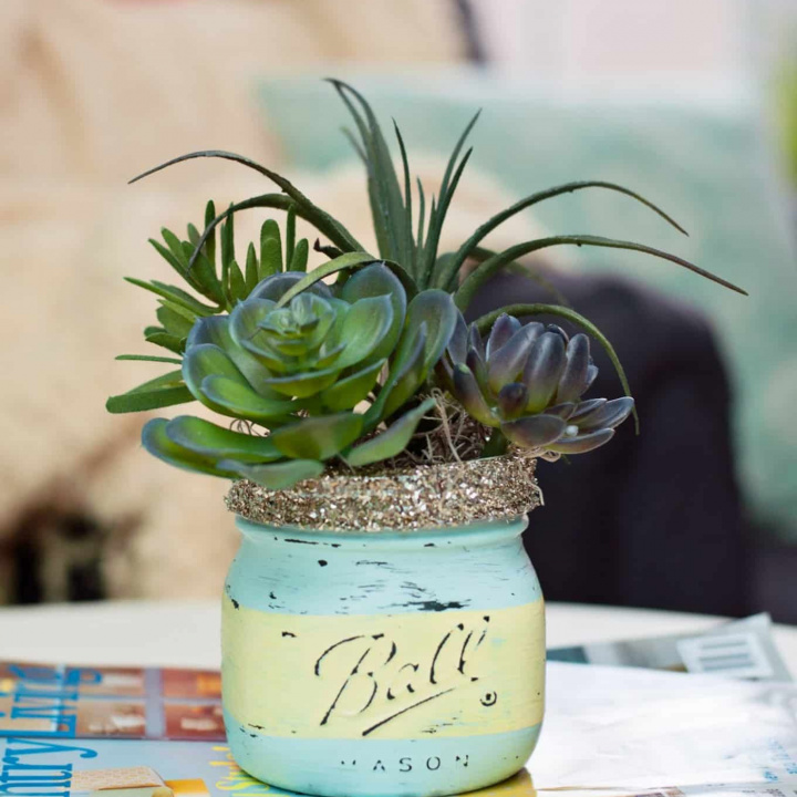Use chalk paint and Mod Podge to create these gorgeous DIY mason jar succulent pots for spring. Perfect for a kitchen windowsill or a seasonal mantel!