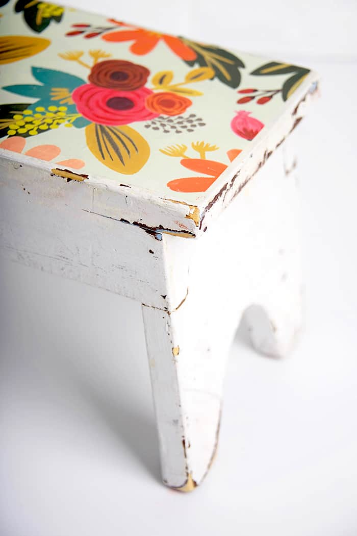 In this DIY stool makeover project, I revamped an antique store find with pretty paper and Mod Podge. It's really easy to do and the results are beautiful!