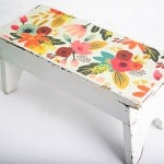 Decorate a wood step stool with paper and Mod Podge