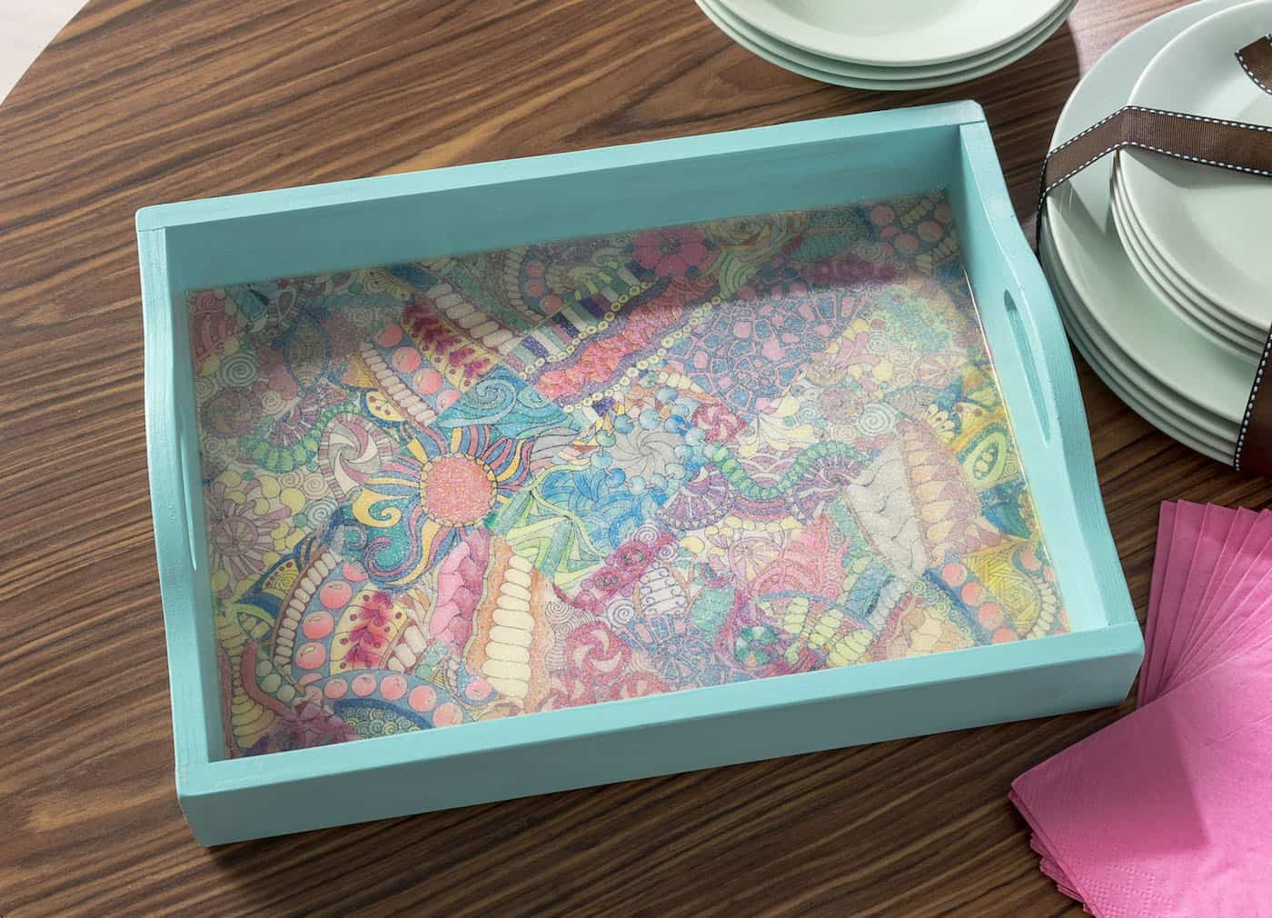 Do you have a bunch of adult coloring pages laying around and aren't sure what to do with them? Decorate a tray! It's easy and makes a great gift idea.