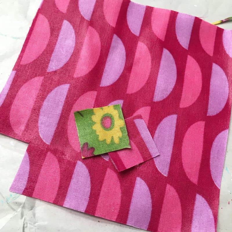 Cutting fabric that has been Mod Podged into small squares