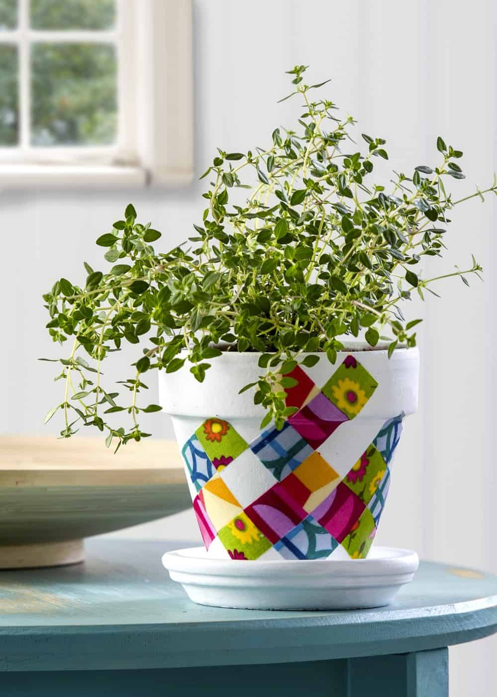 Adding fabric to a clay pot with Mod Podge