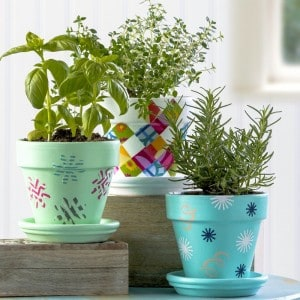 Flower pot decoration using fabric, stencils, and washi tape