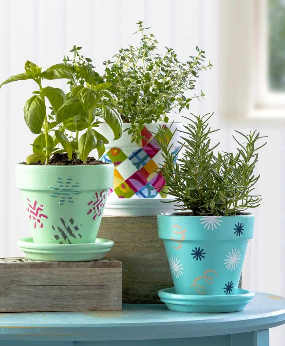 Flower pot decoration using fabric stencils and washi tape & Three Unique Flower Pot Decoration Ideas - Mod Podge Rocks