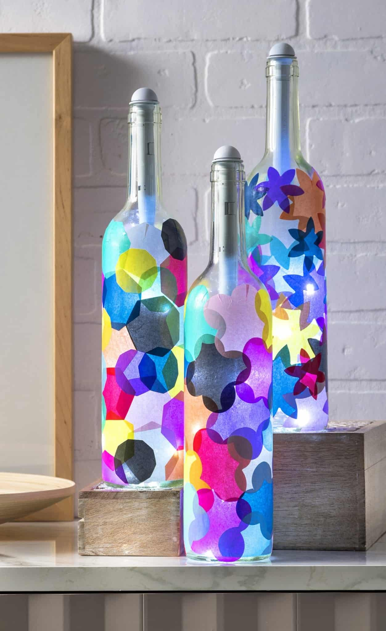 Wine bottle crafts light my bottles mod podge rocks for How to make wine bottle crafts