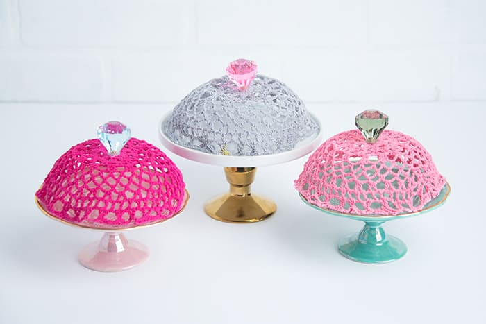 Use Mod Podge Stiffy to create unique doily covers for dessert plates - perfect in place of glass cloches! These are so pretty and easy to make.
