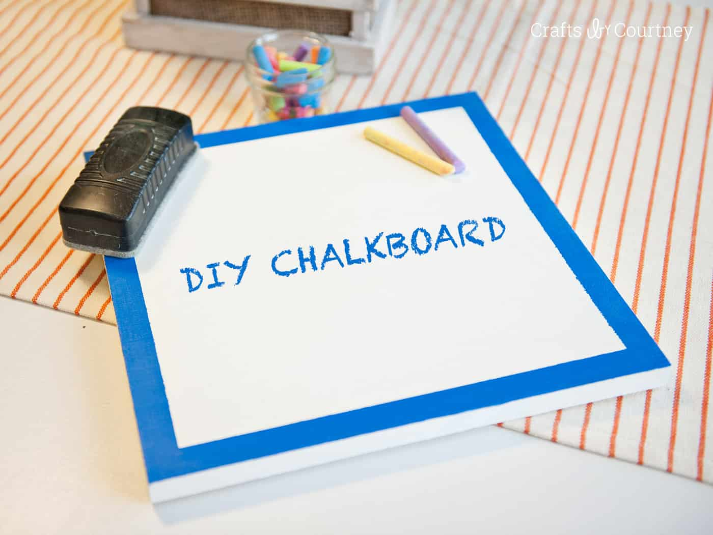 It's so easy to make a DIY chalkboard out of cut wood! You can have any color of paint underneath using a cool, clear chalkboard topcoat.