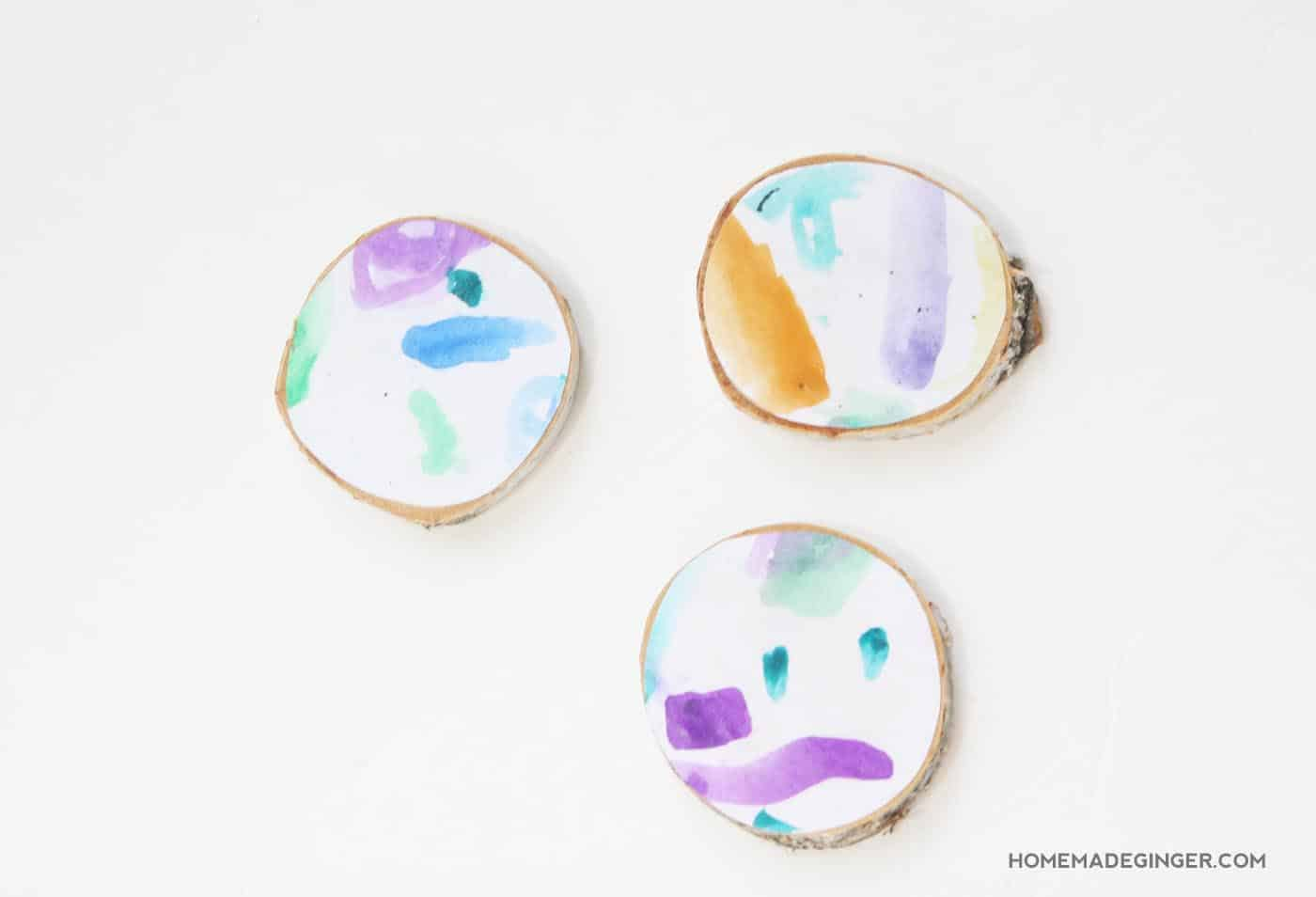 Learn how to make some coasters using kids' art and give them as gifts. Kids can help craft the coasters as well because it's super easy!