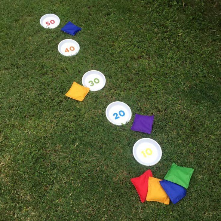 DIY bean bag toss game using clay pot saucers