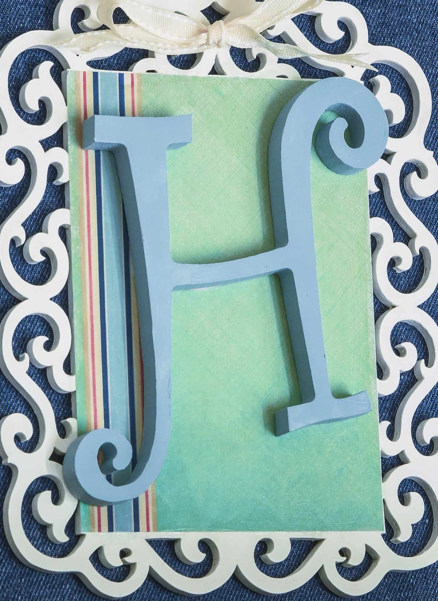 Add a unique, personalized touch to your home decor with this monogram canvas! It's easy to make with a few simple supplies including Mod Podge.