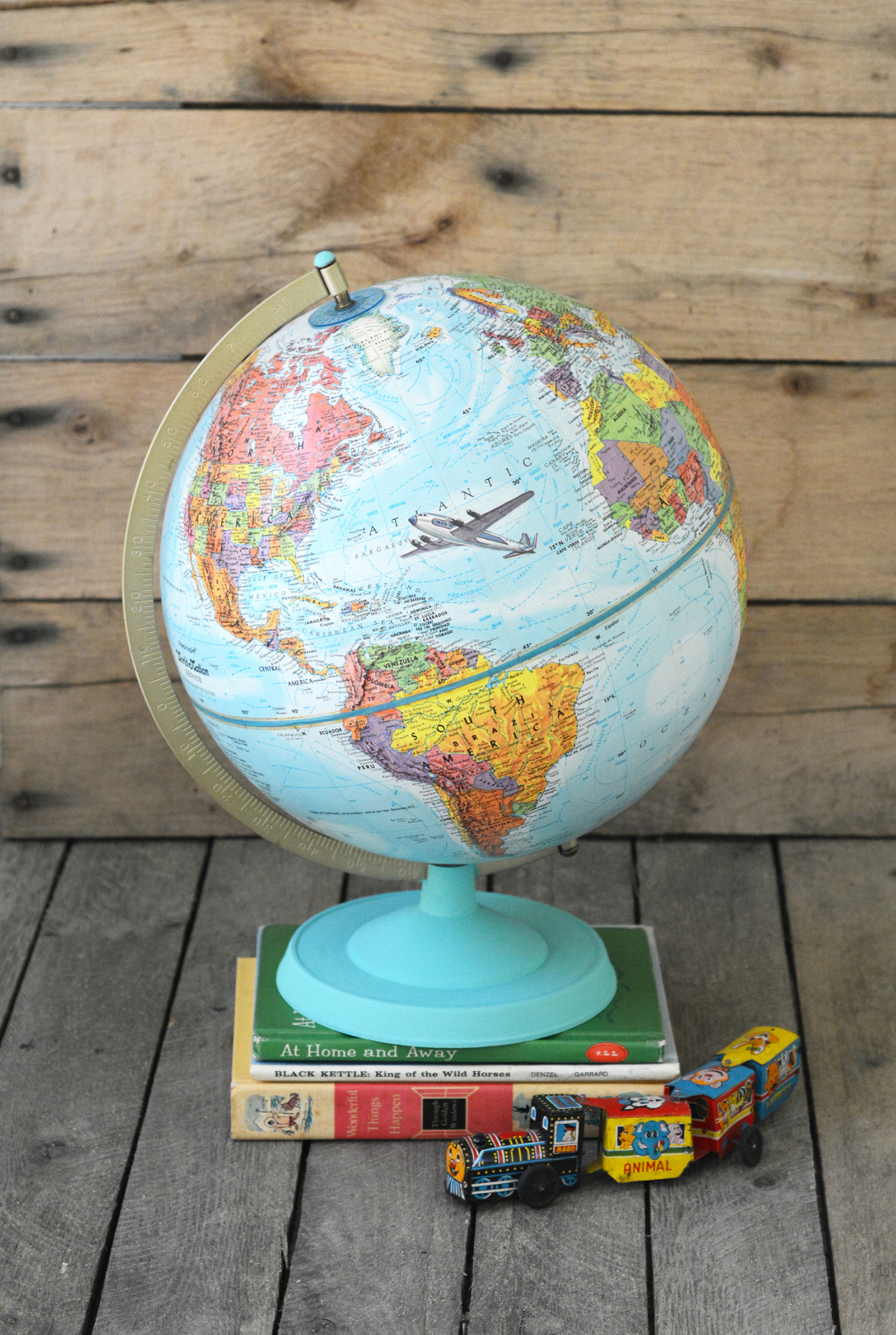 Learn how to customize a vintage globe with your favorite images from children's books - this is such a unique home decor project!