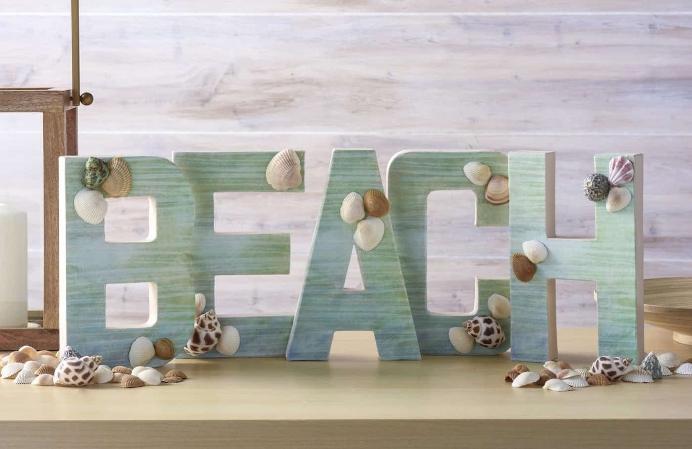 Make a fun project for summer! This DIY letter beach craft would look perfect on your mantel - and it's very easy to assemble with Mod Podge.