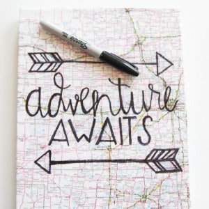 This unique hand lettered map canvas art is an easy and budget friendly way to decor a wall - plus you can customize with any words you like!