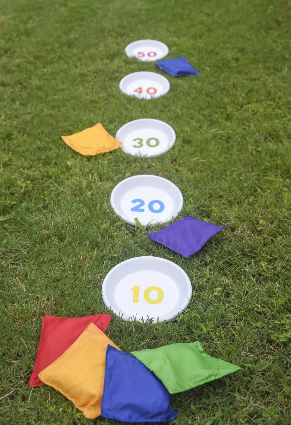 Inspired by a childhood game, I created a bean bag toss using clay saucers and a printable. It's easy to assemble and you'll be having a blast in minutes!