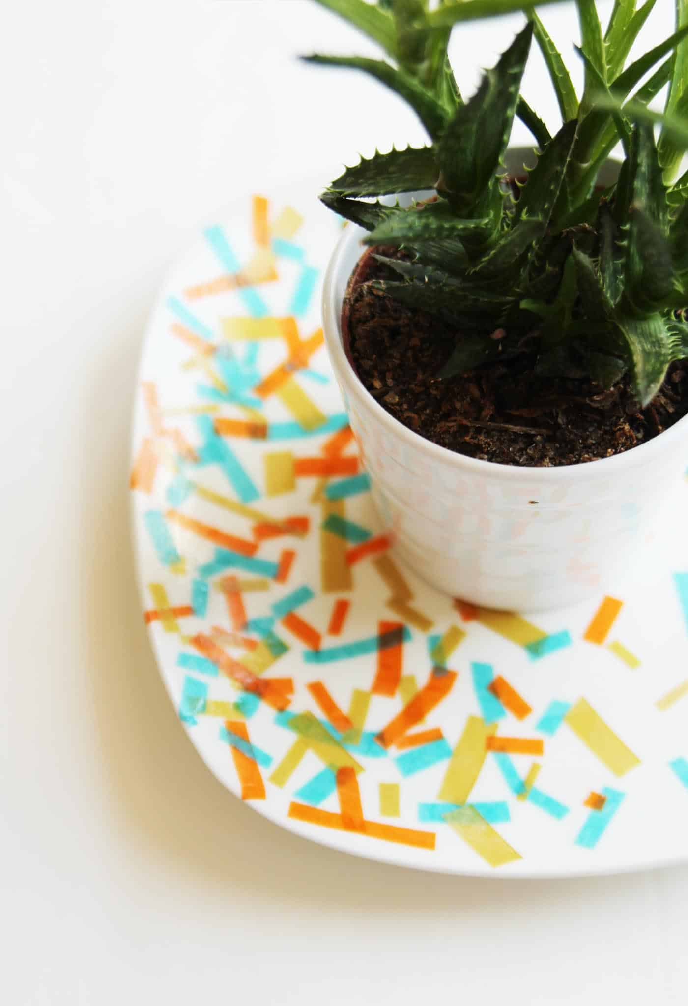 Use various colors of tissue paper and Dishwasher Safe Mod Podge to decorate a plate in this unique dollar store craft. Perfect for parties!