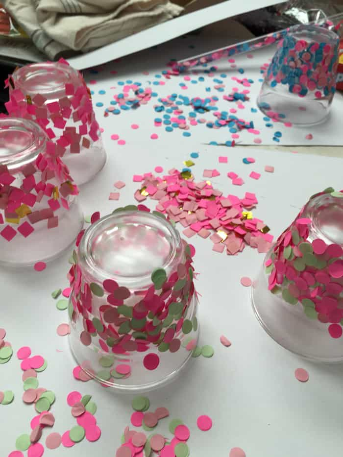 Sprinkled confetti on glass candle holders