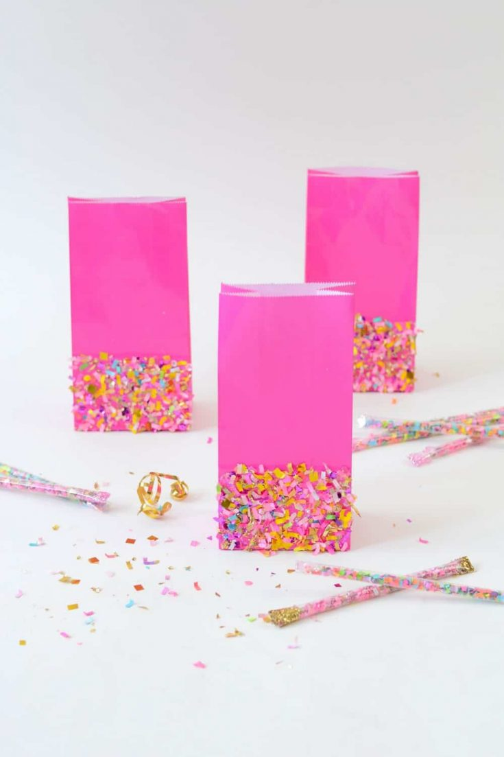 Take your party to the next level with these simple DIY goodie bags! They are so easy to make with colorful confetti and Mod Podge.