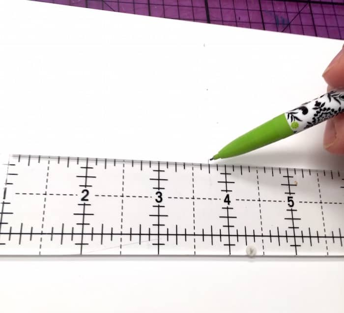 Draw a line with a pencil and clear ruler