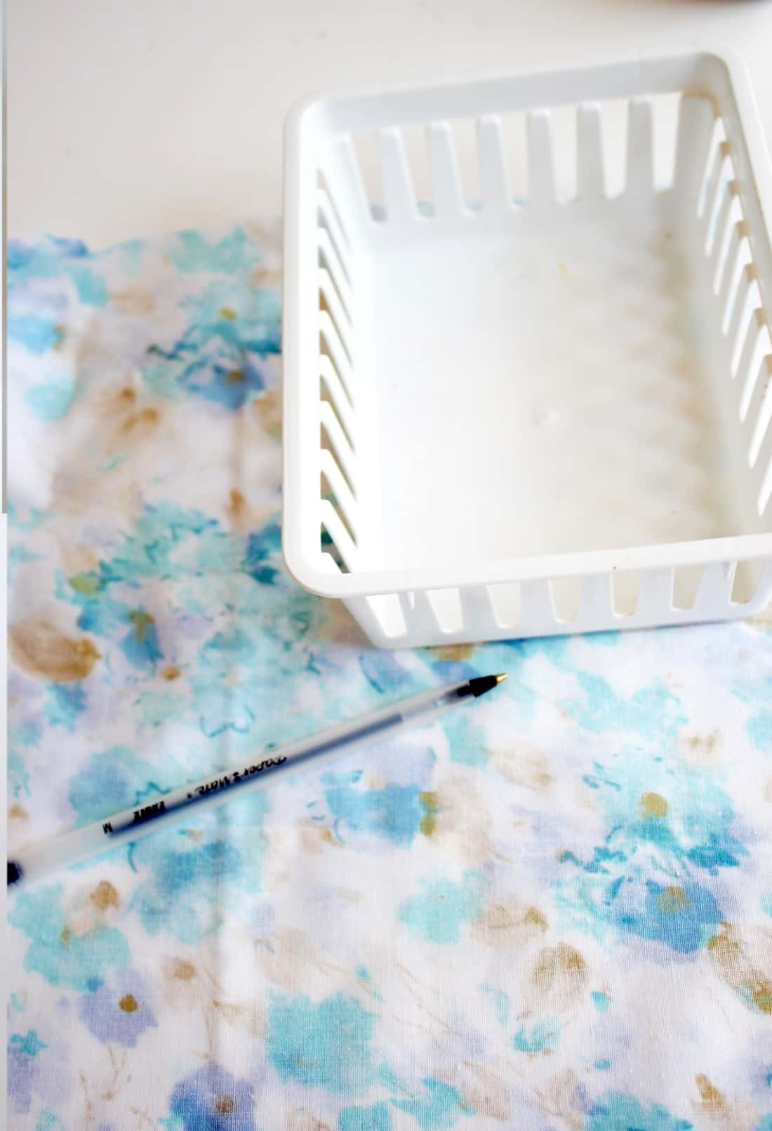 Gussy up some fabric bins with Mod Podge in this easy dollar store craft! This is great for using up those small pieces of fabric for something pretty.