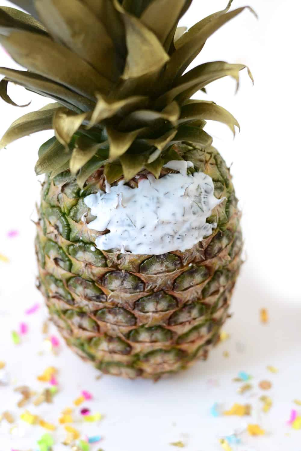 Mod Podge on the side of a pineapple