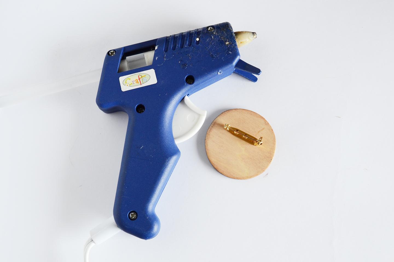 glue pin back onto back of circle