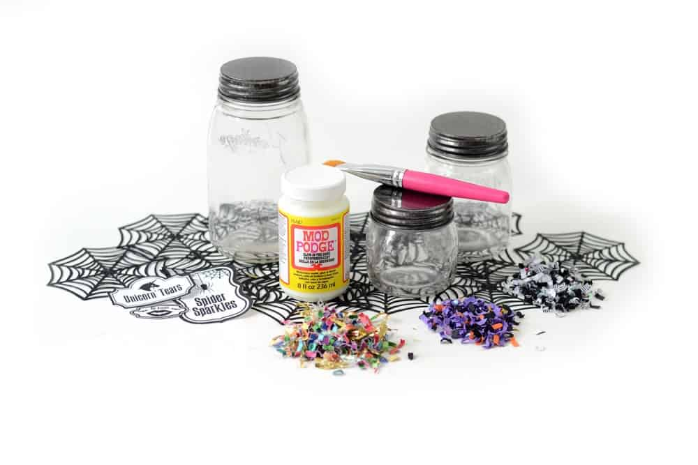 Clear jars with glow Mod Podge and Halloween confetti