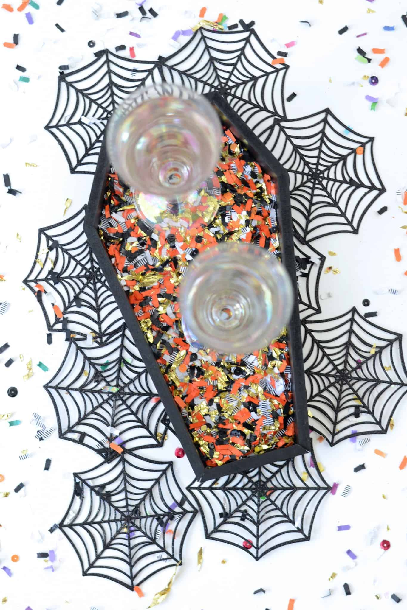 Spice up your Halloween table with DIY confetti coffin tray! It makes the perfect decoration for your next holiday soirée. And who doesn't love confetti?!