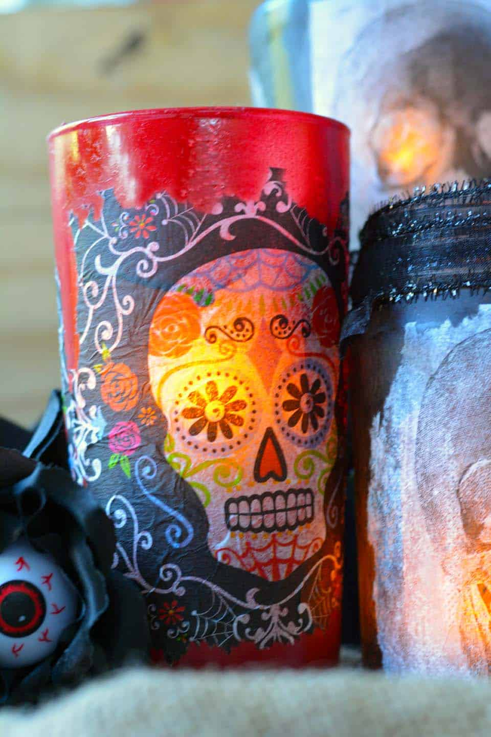 Do you love Day of the Dead crafts? Use napkins to create these unique decorative luminaries! So fun for Halloween and beyond.
