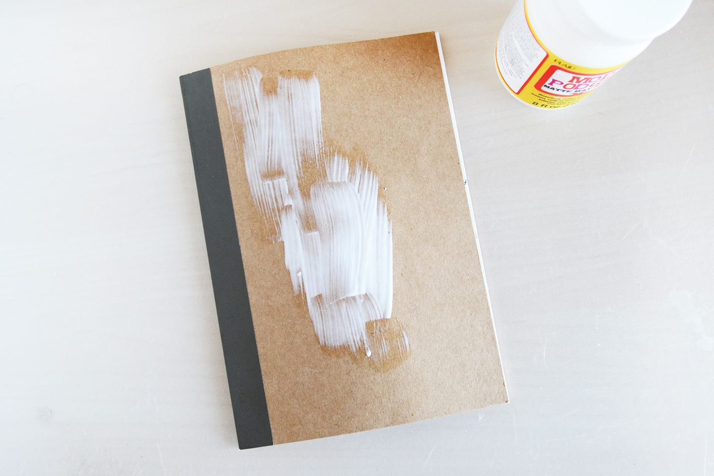 apply-generous-mod-podge-onto-notebook
