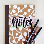 You're going to love this DIY notebook idea, which uses Mod Podge and an overlay to make it pretty. Keep all of your notes and plans inside. So cute!