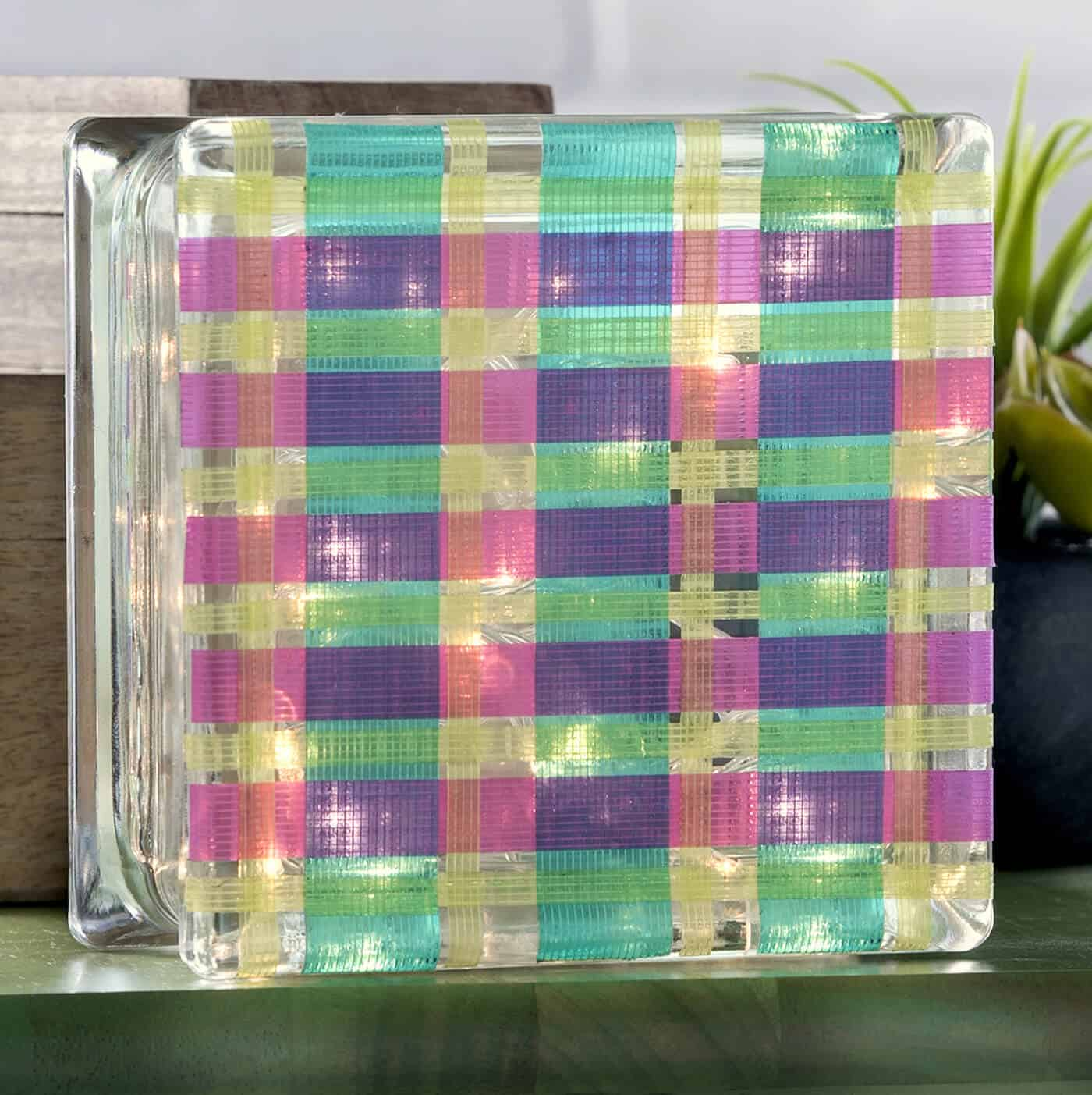 Glass block crafts are so fun and easy! Grab your Duck Tape and glass block from the craft store and make this simple plaid lamp. Perfect for a kids' room!