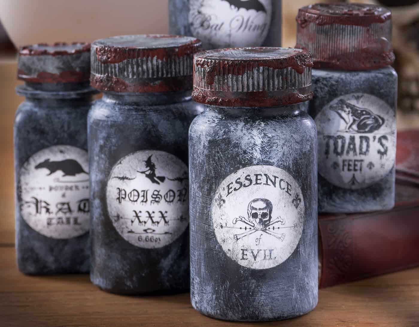 Learn how to make these cool Halloween potion bottles from old pill bottles! Grab free printables in this post, a bottle of Mod Podge, and some paint.