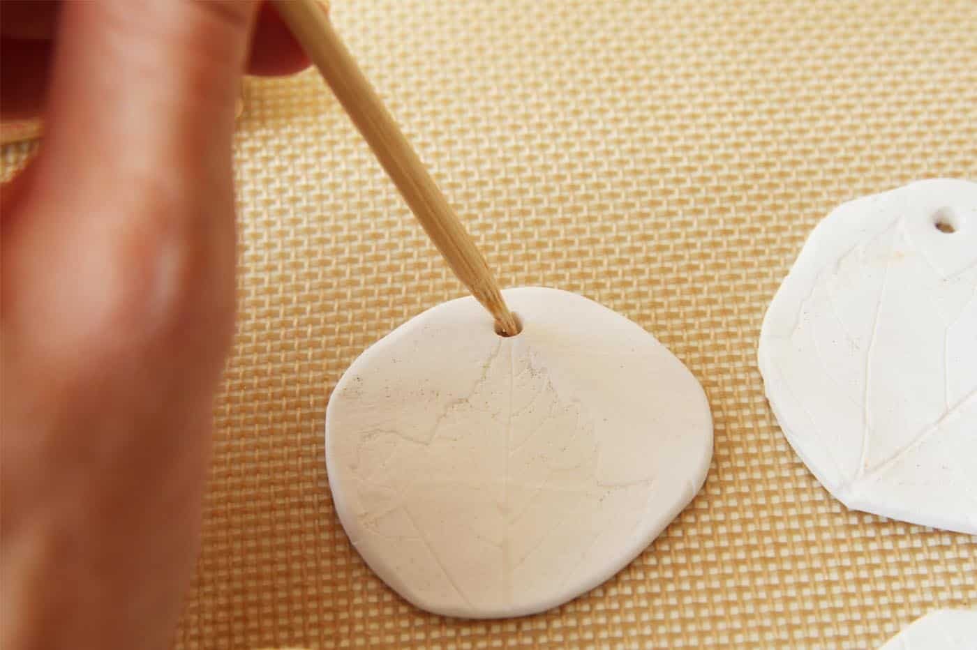 Poke a hole in the top of your clay gift tag