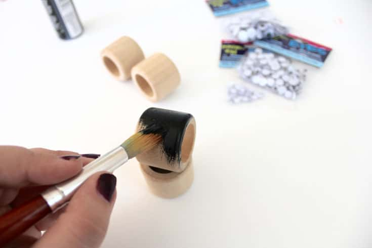 Paint wood napkin rings with black acrylic paint